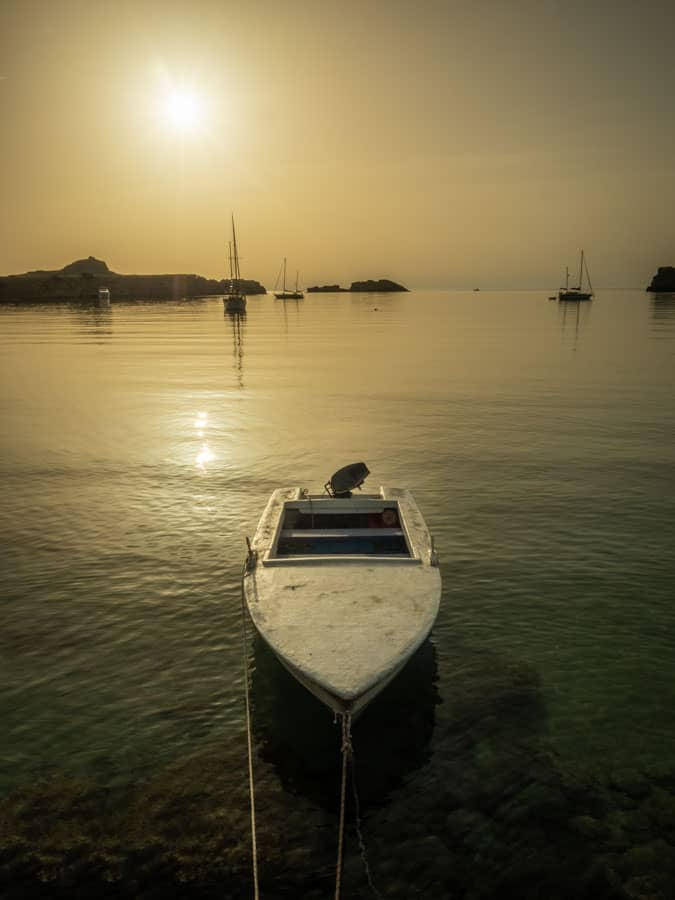 Photo of a boat moored near the main beach in Lindos. This is my favourite time of day to be on the beach, just me, the sun, the sea and the boats and all that lovely morning light