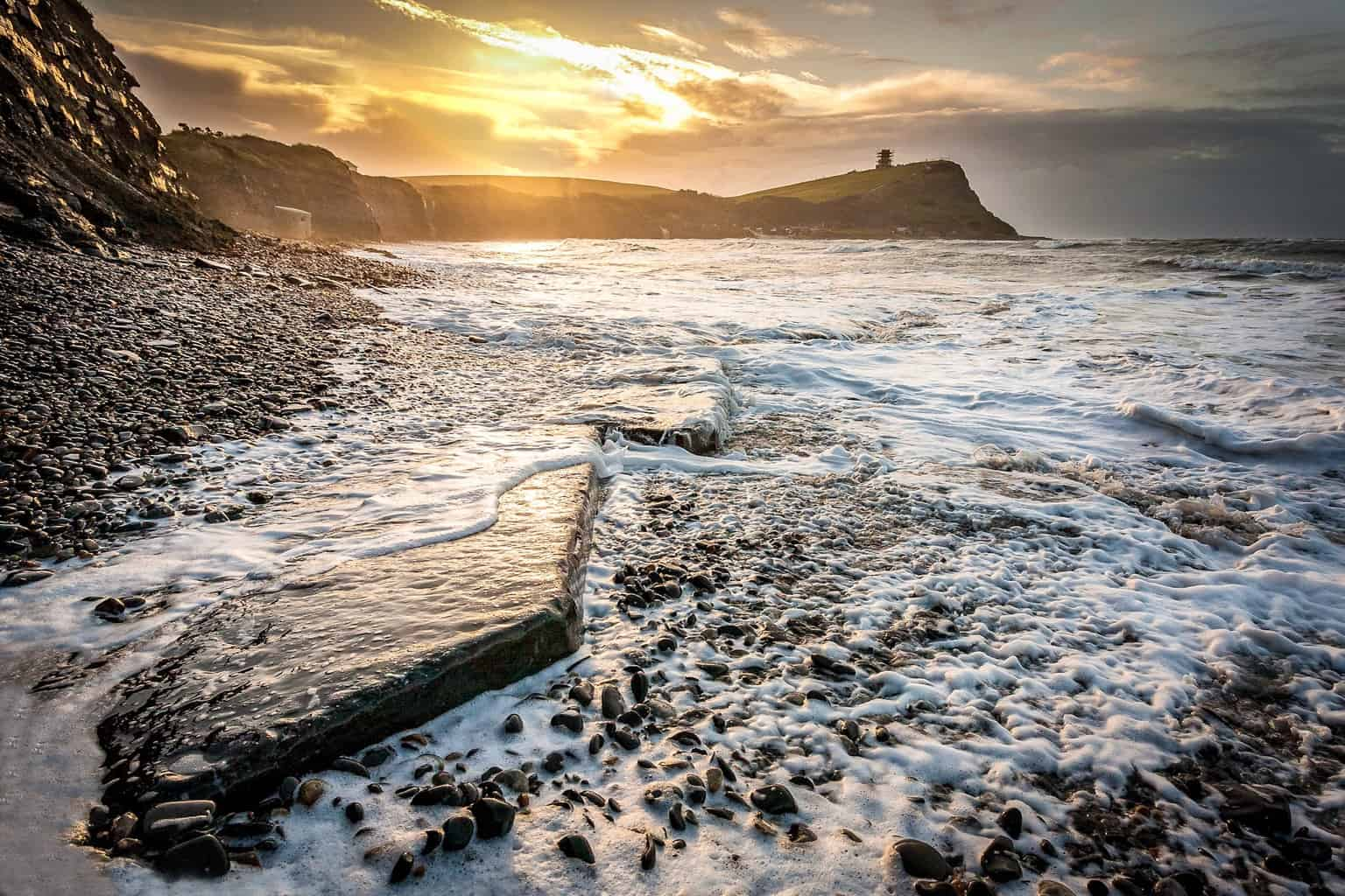 The picture of Kimmeridge Bay at sunrise with the rock in the foreground