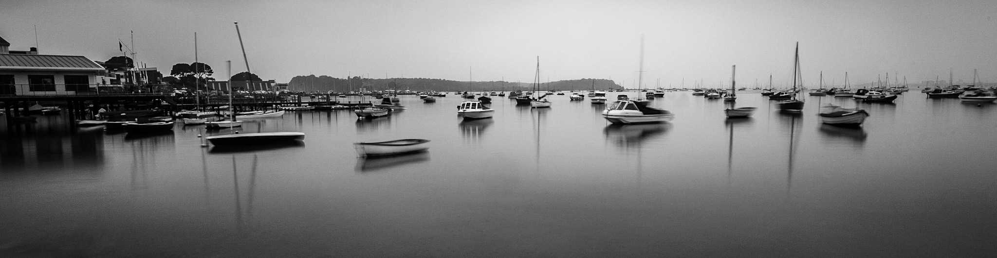 Lovely flat water and Brownsea Island in the background by Sandbanks Photographer Rick McEvoy