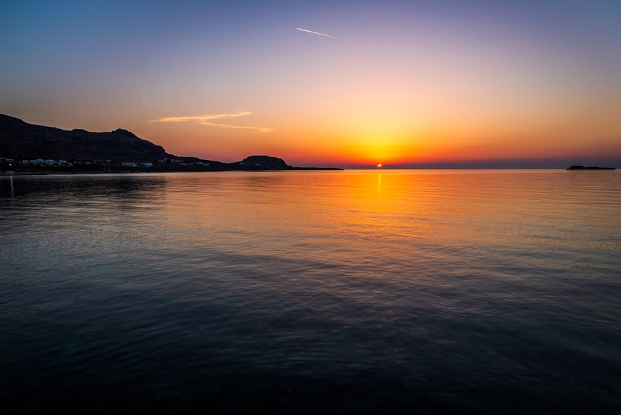The view at sunrise looking towards Lindos from Navarone Bay on the Greek Island of Rhodes