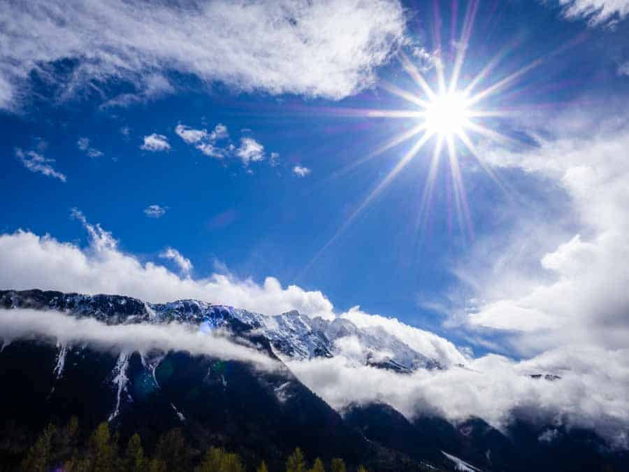 Spring sunshine in the mountains photographed from the glacial valley in Pemberton British Columbia