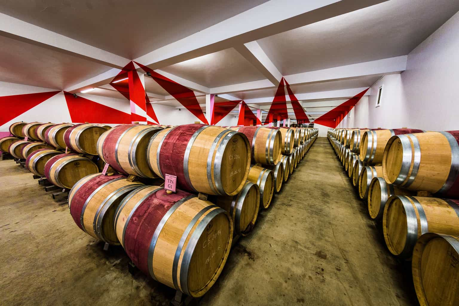 Barrels of wine maturing, Bordeaux, France, by industrial photographer Rick McEvoy