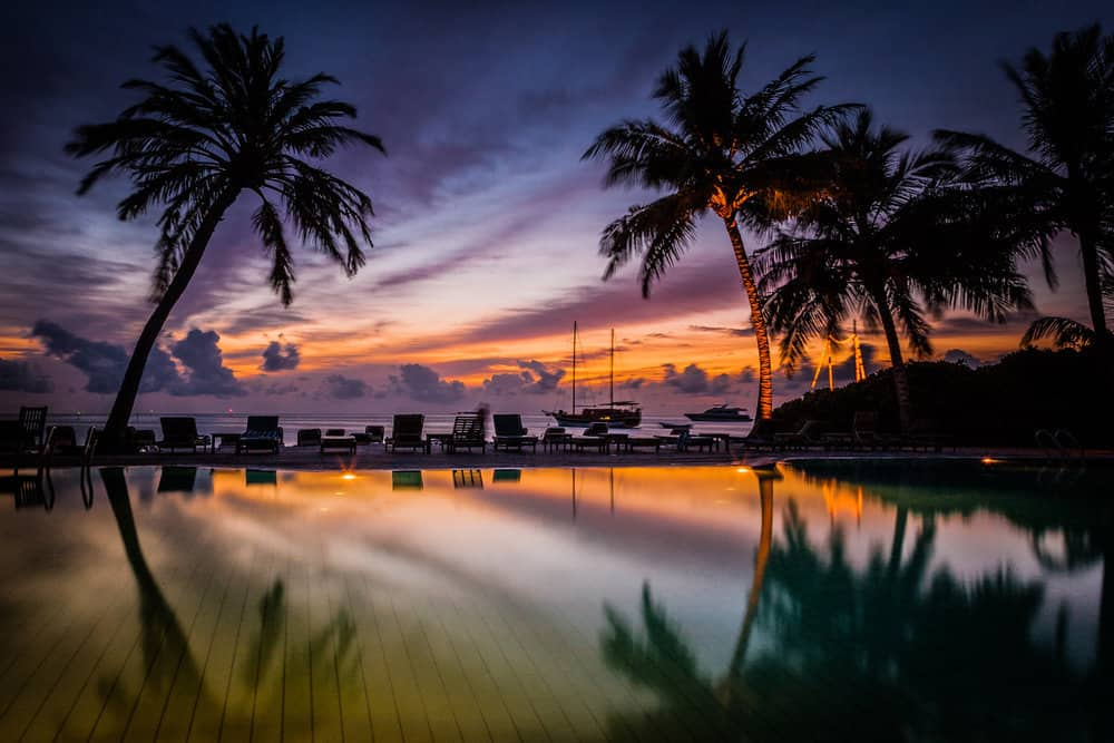 Swimming pool at sunset. Meeru Island Resort. The Maldives. Trav