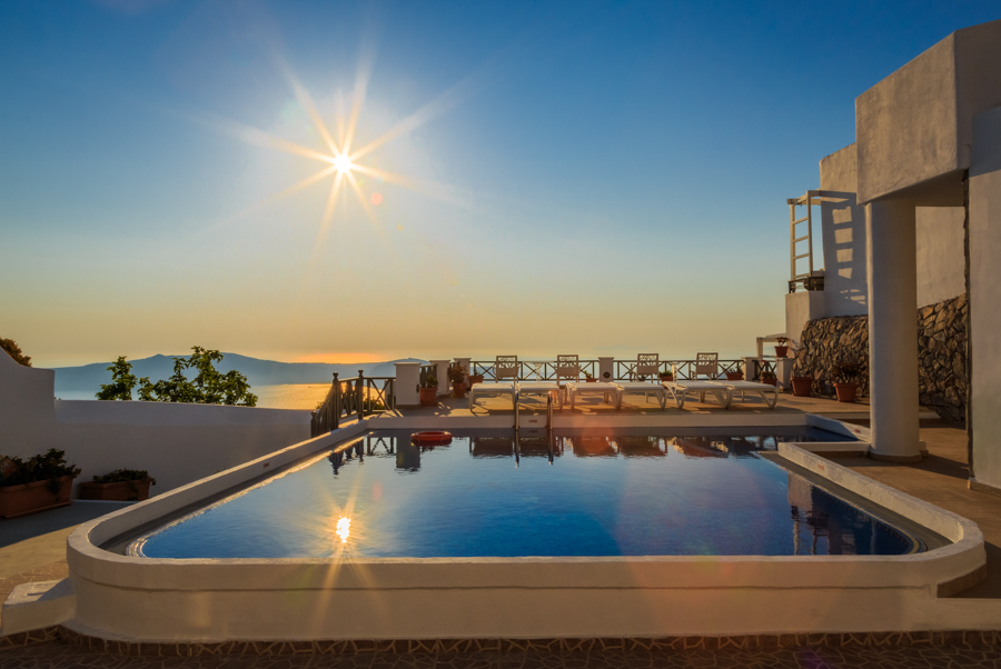 Swimming pool with a stunning view at Kasimatis Suites in Imerov