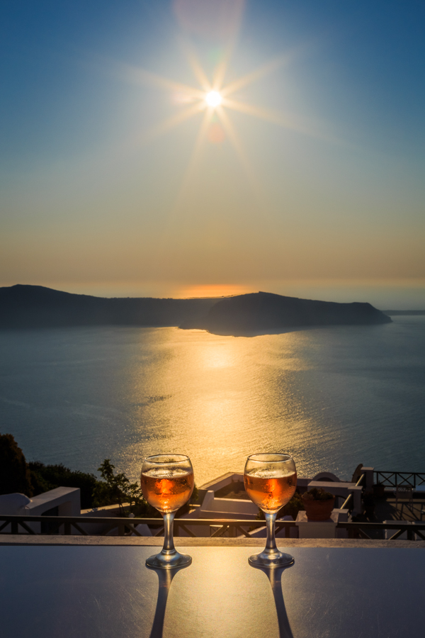 Evening drinks with a sunshine view of the caldera at Kasimatis