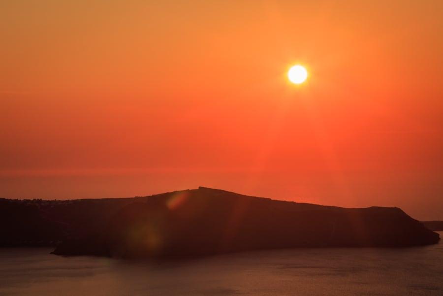 Golden sunshine over Thirasia viewed from mainlaind Santorini