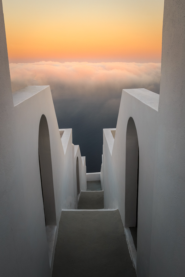 Steps down to the clouds at sunrise at Kasimatis Suites in Santo