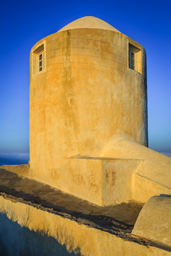 One of the windmill buildings of Santorini at sunrise