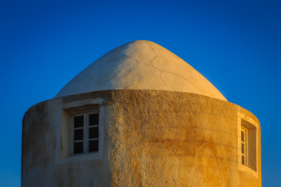Picture of the roof of a windmill in Imerovigli at sunrise