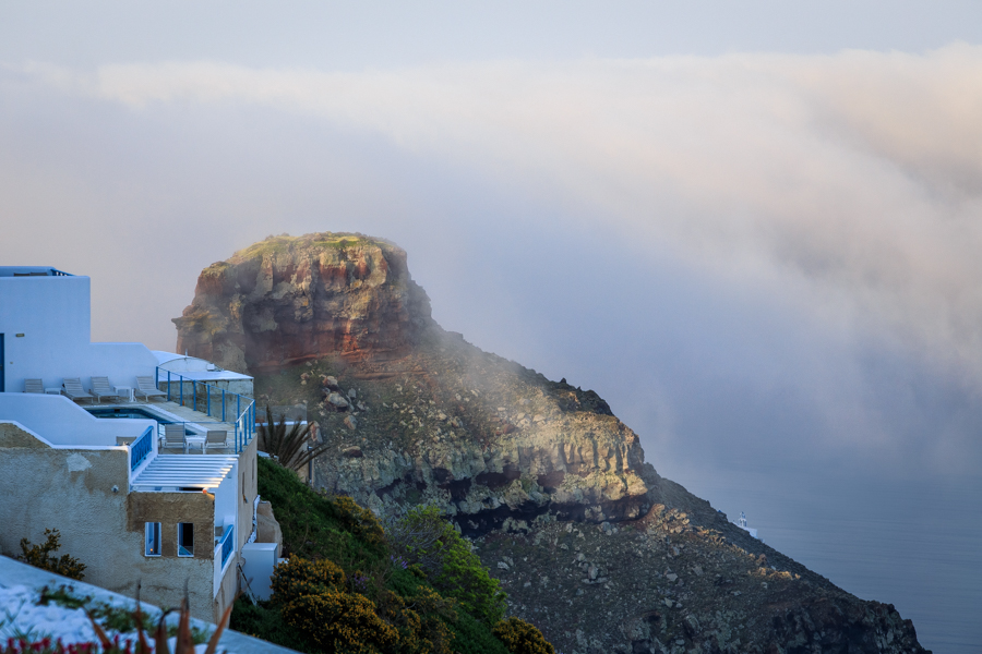 View of Skaros Rock as the clouds clear one morning in Santorini
