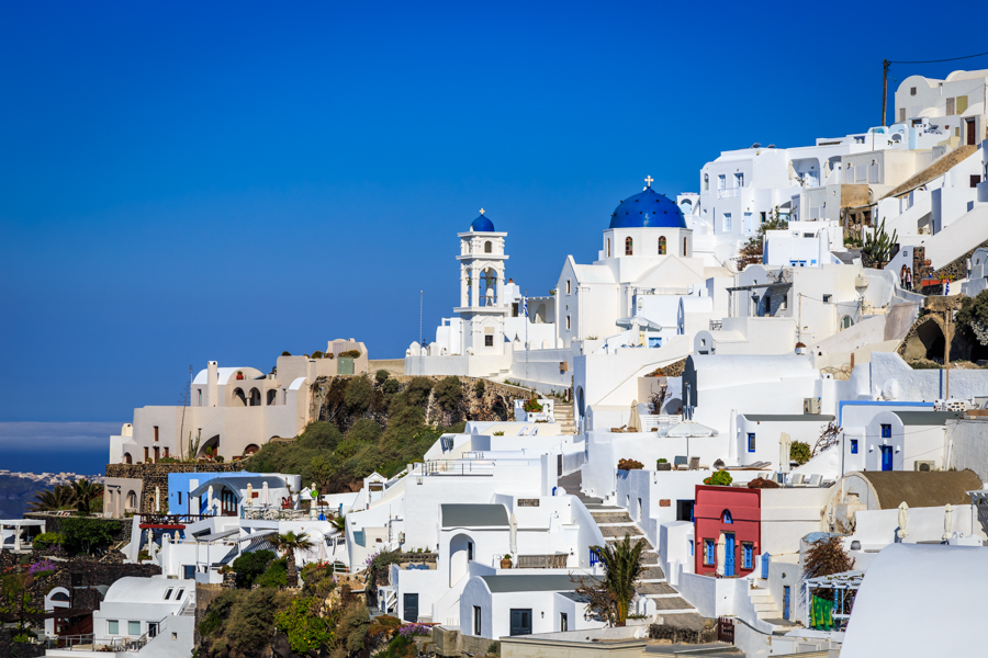 The white buildings and blue roofs of Santorini