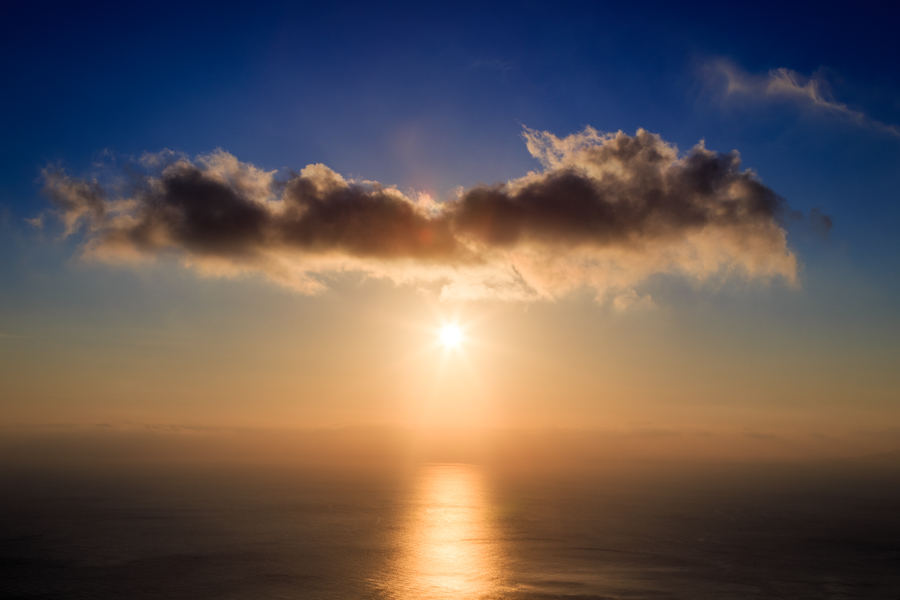 Sunrise picture of the sea, sun and clouds viewed from Santorini