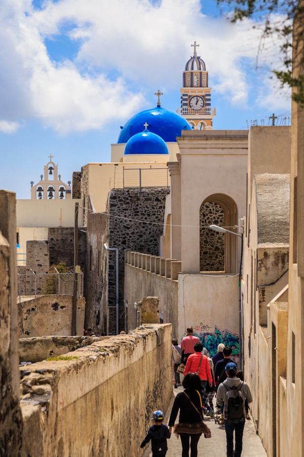 Tourists walking to the churches of Fira in Santorini