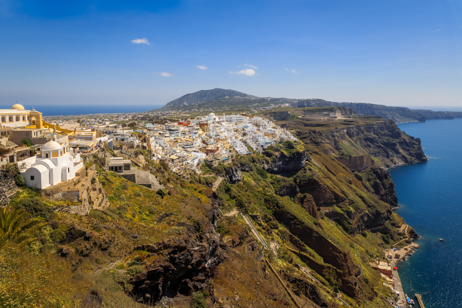 This is the view of Fira, the capital of the wonderful Greek Island of Santorini, photographed from the path from Imerovigli one sunny April afternoon. In this photo you can see how Santorini has developed, with all those white buildings sat on top of the caldera