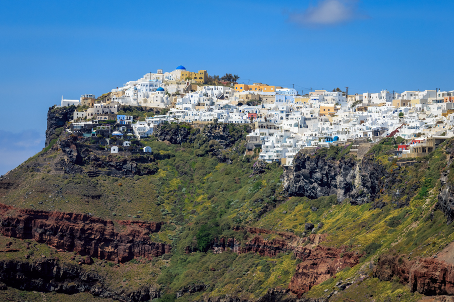 Imerovigli viewed from Fira with the white buildings on top of the caldera