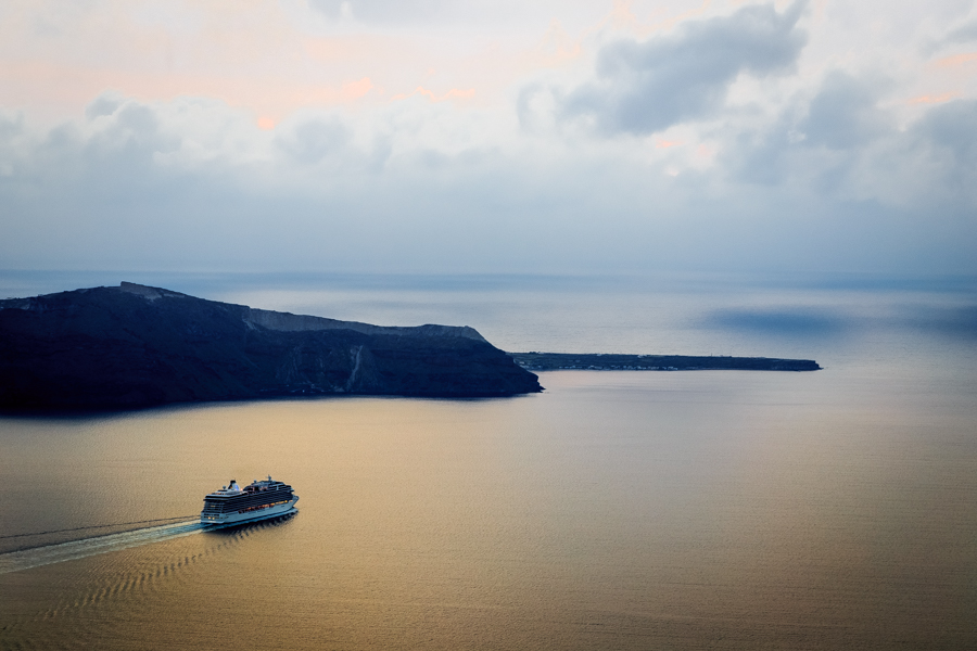Ferry leaving the Port of Fira and the Greek Island of Santorini