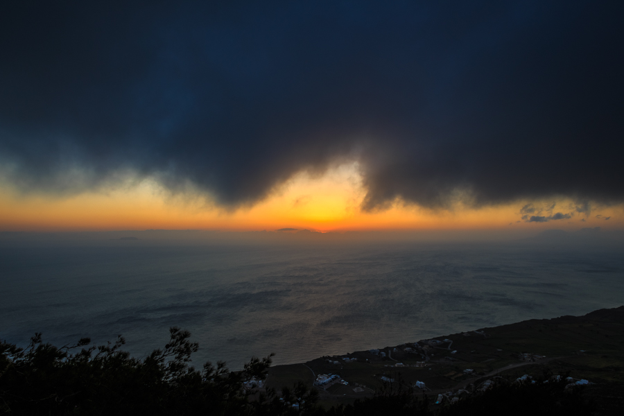 Sunrise clouds viewed from the top of the caldera of Santorini